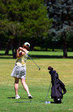 Woman golfing Royalty Free Stock Image