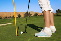 Woman Golfing Royalty Free Stock Photos