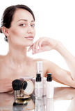 Woman with a good complexion near the creams cosmetics. Skin car Stock Photography