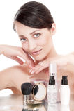 Woman with a good complexion near the creams cosmetics. Stock Photo