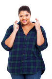 Woman good luck. Pretty young overweight woman keeping her fingers crossed and wishing good luck royalty free stock photos
