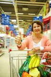 Woman with goods Royalty Free Stock Images
