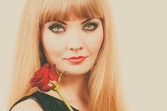 Woman gorgeous girl dark makeup holds rose flower Stock Photography