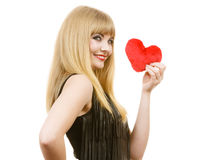 Woman gorgeous girl holding red heart love symbol. Woman elegant blonde long hair girl dark makeup red lipstick holding red heart love symbol flirting, studio royalty free stock photo