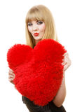 Woman gorgeous girl holding red heart love symbol. Woman elegant blonde long hair girl dark makeup red lipstick holding red heart love symbol flirting, studio royalty free stock photography