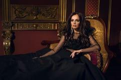 Woman in gorgeous luxury black dress Royalty Free Stock Photos