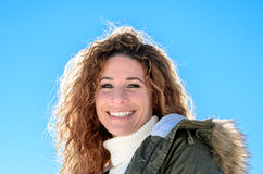 Woman with a gorgeous smile backlit by the sun Stock Image