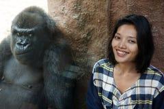 Woman at the gorilla enclosure. Zoo visitor at the gorilla enclosure Royalty Free Stock Photo