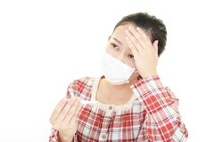 Woman got a cold. Woman wearing a flu mask stock photos