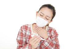 Woman got a cold. Woman in bad condition having flu stock photography