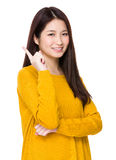 Woman got a new idea with one finger up Stock Photo