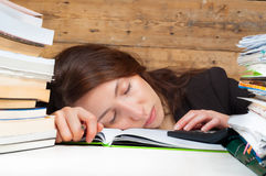 Woman got tired of working and studying next to the stack Royalty Free Stock Photography