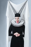Woman in a gothic clothing Stock Photography