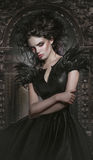 Woman in gothic fashion dress. Woman in gothic black  fashion dress Royalty Free Stock Photography