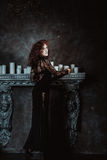 Woman in gothic interior Stock Image
