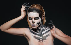 Woman with gothic terrifying makeup posing. Over black background Stock Photography