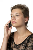 Woman in gown with cellphone Stock Photography