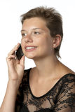 Woman in gown with cellphone Royalty Free Stock Images
