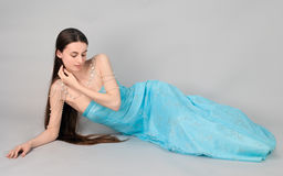 Woman in Gown and Jewelry Stock Photo