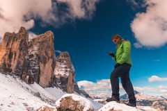 Woman with GPS navigator in hand  Dolomites Alps Stock Photo
