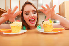 Woman grabbing delicious sweet cake. Gluttony. Royalty Free Stock Photos