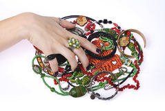 Woman grabbing jewelry. A woman's hand grabbing jewelry Stock Images