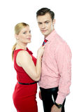 Woman grabbing man from his tie Royalty Free Stock Image