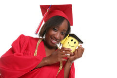 Woman graduate with coffee mug Stock Photos