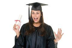 Woman Graduate With Diploma 9. Very happy and proud beautiful young woman standing in graduation robes, cap and gown smiling and holding her diploma or degree Royalty Free Stock Images