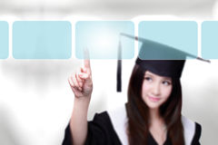 Woman graduate student choosing Royalty Free Stock Photo