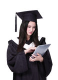 Woman graduate student using tablet pc Stock Photography