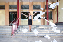 Woman graduates. School and discards all her paperwork Stock Photo