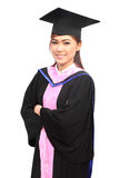 Woman with graduation cap and gown Stock Photography