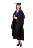 Woman in graduation gown Royalty Free Stock Images
