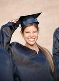 Woman In Graduation Gown Holding Mortar Board On Royalty Free Stock Images
