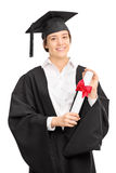 Woman in graduation gown posing with a diploma Stock Photo