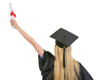 Woman in graduation gown rejoicing success Royalty Free Stock Photo