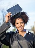 Woman In Graduation Gown Wearing Mortar Board On Royalty Free Stock Photos