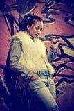 Woman at graffiti wall Royalty Free Stock Photo