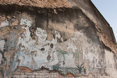 Woman Graffiti on the wall of old house Royalty Free Stock Image