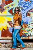 Woman at graffitti wall Royalty Free Stock Photography