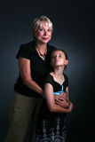 Woman and granddaughter Stock Images