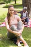 Woman with grandmother and granddaughter in background at park Royalty Free Stock Images