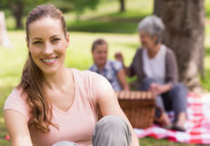 Woman with grandmother and granddaughter in background at park Stock Photography