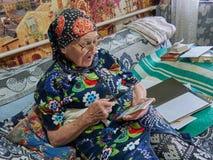 Woman grandmother sitting sofa admiration device smartphone joy delight media communication vision eyes glass stock photo