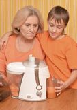 Woman and grandson in the kitchen Stock Images