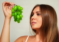 Woman and grape Royalty Free Stock Image