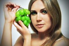 Woman and grape Stock Image