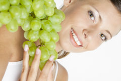 Woman with grape Stock Images