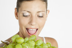Woman with grape. Portrait of young woman with grape Royalty Free Stock Images